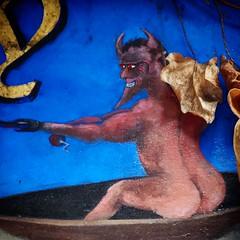 Old Nick goes fishing (oldrockerward) Tags: london naked restaurant fishing butt horns satan grin grinning devil coventgarden chin buttocks sarastro redeyes oldnick