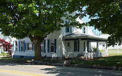 House  North Hampton, Ohio (Pythaglio) Tags: county street blue trees windows ohio sky white house brick window altered fence painted north columns picture 11 historic sidewalk shade clark porch shutters hampton residence twostory ionic crude dwelling saltbox
