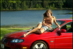 IMG_3822_Red Pontiac GTO and a girl in shorts sitting on the windshield.. (donaldbrainard1) Tags: red summer lake color water girl beautiful car fashion canon model sitting legs performance style barefoot 7d blonde shorts pontiac gto lovely boho bohemian sportscar