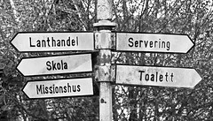 The Old Sign (Tim Lindstedt) Tags: old blackandwhite bw favorite white inspiration black slr art monochrome beautiful beauty sign composition digital canon photography eos grey mono photo spring scenery afternoon view post image sweden great scenic picture best photograph scenary views april imagination sverige signpost dslr capture province vsters guidepost greyscale timlindstedt