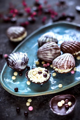 hocolate sweets in the form of cockleshells. Dark stone background. (azimavu) Tags: chocolate sweet sweets dessert background food candy delicious brown cocoa dark gourmet closeup white tasty eat praline assortment snack chocolates gift sugar macro black cream bonbon milk bitter ingredient calorie confectionery wooden cacao fat truffle group many variety chocolatebean coffebean cockleshell figure chocolatefigure plate blue sea hollyday bithdayparty