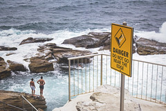 Danger Sign (Schwaco) Tags: ocean cliff fall beach water sign yellow danger swim rebel rocks waves dive sydney australia dont edge caution coogee donot coogeebeach rebelious whitecaps sydneyaustralia rebelion whitecape