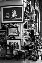 (Georgina ) Tags: pictures blackandwhite monochrome shop gun outdoor athens greece antiques lamps stools vases phonograph oldradio smokingtable shipswheels