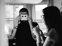 Wally (BurlapZack) Tags: portrait bw monochrome tattoo bread mono sill mask bokeh availablelight indoor binoculars handheld playingwithfood peepers eyeholes jeeperscreepers breadface pack06 arlingtontx breadmask olympusmzuiko45mmf18 vscofilm olympusomdem5markii
