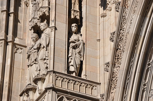 Barcelona. Cathedral church of the Holy Cross and Saint Eulalia. Neo-Gothic facade. Saints Maria of Cervelló, Joseph Oriol and Raymond of Penyafort. 1887-1890. Agapit Vallmitjana, sculptor