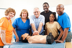 Class on CPR and First Aid (olaruwaju) Tags: cpr cardiopulmonaryresuscitation lifesaving dummy doll class school firstaid adulteducation emt emergency procedure chestcompression student adult teacher instructor doctor physician medical healthcare nurse female woman plussize overweight man male people person mannequin training learning group students watching mature caucasian teaching classroom practice education africanamerican african black minority diversity ethnicity smiling practicing