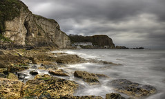 Portbraddon from Whitepark Bay (Glenn Cartmill) Tags: uk ireland sea nature water clouds canon eos scenery rocks photos unitedkingdom glenn may cliffs northernireland northern darkclouds whitepark ulster northcoast countylondonderry whiteparkbay cartmill 2013 650d t4i portbraddon picturesofireland glenncartmill