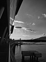 Coal Harbour B&W (dons projects) Tags: city shadow blackandwhite sun canada building water sunshine skyline architecture vancouver clouds harbor bc waterfront harbour may angles sunny olympus canadian walkway promenade rails conventioncenter railing olympuspen sonnig sonne zuiko vancouverbc coalharbour zd mft fourthirds 2013 1442mm photoscape seeninvancouver epl1 microfourthirds 43 mzuiko m1442mm olympuspenepl1 seaplanecenter donsprojects