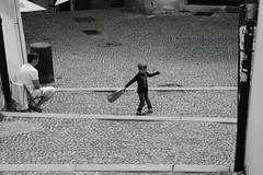 Turning around (Bemijoca) Tags: boy blackandwhite bw man bag republic czech pavement cobblestone around turning twisting