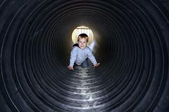 Halo - _TNY4373 (Calle Sderberg) Tags: boy smile playground child pentax circles flash pipe kitlens halo tunnel istds pentaxistds smcpentaxda1855mmf3556al