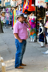 Let's Make a Deal (Rock Steady Images) Tags: camera pink vacation man hat shirt canon eos costarica cowboy phone boots stripes events streetphotography cell places equipment jeans coco cameras 7d processing handheld 200views 50views lenses topaz riu guanacaste 25views niksoftware bypaulchambers canonef2470mmf28iiusm lightroom4 photoshopcs6 rocksteadyimages