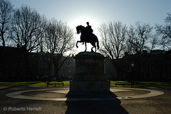 Silhouette of statue and trees in Queen Square, Bristol (Roberto Herrett) Tags: city uk travel blue trees england sky urban horse man english tourism grass sunshine k silhouette horizontal architecture buildings bristol outside europe unitedkingdom britain sightseeing cities statues halo sunny places tourist gloucestershire architectural historic u historical british backlit towns horseback sights locations stockphoto exteriors horseman rherrettflk