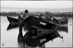 The Tranquility of the Sea (dajethy) Tags: sea bw black barche pescatore dajethy seaendsky dajethytuttiidirittisonoprotettidalmarchioregistra dajethytuttiidirittisonoprotettidalmarchioregistrato dajethytuttiidirittisonoprotettidalmarchioregistrato