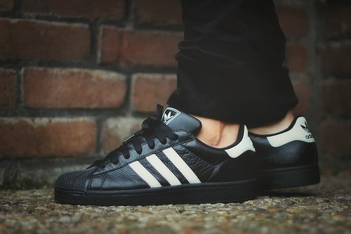 Adidas Superstar Black And Gold On Feet