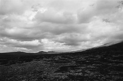 Desolation (IggyRox) Tags: sky blackandwhite mountains film nature norway clouds 35mm norge europe empty north hike huge scandinavia barren emptiness desolation rondane vast oppland rondanenationalpark sjoberget gravhoe