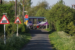 BR Leyland Pacer Class 142 speeds past Crabtree Lane LC in a blur with the  1F02 Manchester Victoria to Southport service on a very sunny 9th May 2016 © (steamdriver12) Tags: road signs west rural manchester spring crossing br risk time may rail sunny victoria class lancashire stop level lane service british gated lc northern railways southport 142 8th pacer speeds crabtree leyland 2016 grounding 1f02