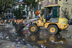 Reflecting on Mardi Gras Clean-Up (BKHagar *Kim*) Tags: street carnival people reflection yellow trash beads neworleans crowd cleanup equipment cups napoleon nola mardigras frontendloader throws rakes bkhagar