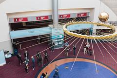DSCF5882.jpg (mikepirnat) Tags: people sculpture signs art oregon reflections portland carpet words community crowd python conferences pendulum pycon oregonconventioncenter pycon2016