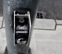 Grime (mightyquinninwky) Tags: seattle sign graffiti washington kri tag tags tagged button ballard grime crosswalk seattlewashington refective crosswalkbutton crosswalksignalbutton  ykri
