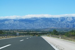 coverlet of clouds :) (green_lover) Tags: croatia road mountains clouds landscape vanishingpoint