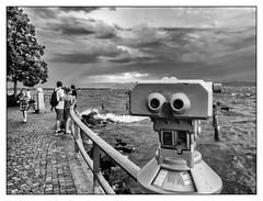 The Look (Foto_Michel) Tags: street water face clouds way blackwhite gesicht wasser waves streetphotography wolken menschen human schwarzweiss bodensee fernglas weg wellen gelnder bedrohlich