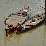 Woman Doing Laundry from the Side of a Fishing Boat 3 thumbnail