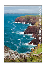 The Red Cliffs of Skokholm (Winterspeak) Tags: ocean park uk red sea summer portrait cliff cloud sun nature water sunshine rock vertical wales clouds de island anne grey coast countryside marine sandstone rocks europe surf waves view natural cloudy britain cove south united country great gray cymru scenic july rocky reserve wave kingdom sunny nobody scene cliffs coastal national edge views gb gilbert waters coastline remote summertime geology sir upright picturesque pembrokeshire isolated 2012 ynys arfordir penfro skokholm cenedlaethol sgogwm sgocholm