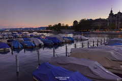 The More You Know, the Less You Need (Alessio Lo Re) Tags: blue light sunset shadow red white lake reflection river boats dawn boat harbour zurich hour