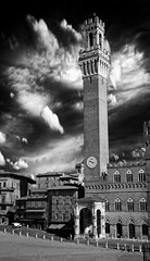 Torre del Mangia B/W (l.cutolo) Tags: blackandwhite bw italy tower monochrome glow cityscape action streetphotography siena oldtown citycentre mangia crazyclouds sunlights worldtrekker sharplights amazingdetails e18200mmf3563oss perfecteffect perfectlayer sharpfocusinthecentre softfocusattheback