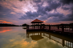 Silence (zollatiff) Tags: longexposure travel light sunset sky lake reflection nature water colors clouds landscape evening pier twilight nikon scenery dusk horizon structures peaceful tranquility calm silence harmony malaysia serene bluehour putrajaya tranquil foreground wetland waterscape federalterritory putrajayamalaysia putrajayawetland zollatiff