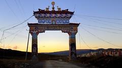The entrance gate of Yarchen Gar (reurinkjan) Tags: dzogchen 2013 tsokpa yachengar བོད་ལྗོངས། ©janreurink tibetanplateauབོད་མཐོ་སྒང་bötogang tibetབོད buddhistསངས་རྒྱས་ཆོས་ལུགས་པ དགོན་པ་ nunneryཨ་ནི་དགོན་པ་anidgonpa monkགྲྭ་བ།grwaba buddhismསངས་རྒྱས་ཆོས་ལུགས།sangsrgyaschoslugs yarchengar greatertibetབོད་ཆེན་པོböchenpo tibetannationalitytibetansབོད་རིགས།bodrigs ཆུ་ nunཇོ་མོ།ani khamཁམས།easterntibet nyingmaredhatsectརྙིང་མrnyingma ༢༠༡༣ khamཁམས་བོད khamsbodkhamwö pelyülདཔལ་ཡུལ།county nyingmapahermitage yarchengarཡར་ཆེན་སྒར་ lamaachukrinpoche yellegar rinchenlingpa yachengönཡ་ཆེན་དགོན། yachengarཡ་ཆེན་དཀར་། stupaམཆོད་རྟེན༏mchodrtenchorten yarchengön dzinchu ཛིན་ tibetannationtibetanpeopleབོད་ཀྱི་མི་བརྒྱུད bökyimigyü sisterhoodཨ་ནིའི་ཚོགས་པani yarchengonpaཡར་ཆེན་