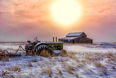 Wisdom (Pat Kavanagh) Tags: tractor canada farm alberta goinghome prairie wisdom retired prairies vision:sunset=0888 vision:sky=0713