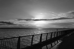 Quiet Reflection (Bosca Fotograf) Tags: sunset sea blackandwhite seascape black reflection water clouds liverpool puddle promenade andwhite otterspool bhoys