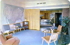 Tourinns Motor Courts lobby (Edge and corner wear) Tags: glass vintage hotel tv inn chair fireplace furniture map interior room postcard motel case lodge lobby chrome wakefield motor aaa furnishings heywood cbhairs
