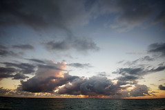 rising  sun (mariola aga) Tags: ocean summer sky sun distortion clouds sunrise rising dominicanrepublic wideangle atlanticocean puntacana bavaro thegalaxy 1020mmsigma infinitexposure