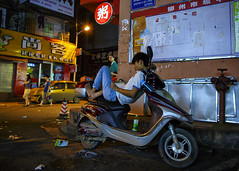 Balancing Act (Michael Steverson) Tags: china street city urban man night asian asia chinese scooter chinadigitaltimes reclining guangxi