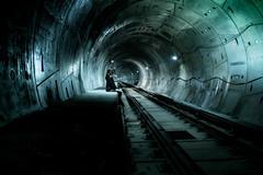 pre.view (jonathancastellino) Tags: leica light colour train dark circle underground track sitting tube tunnel m summicron transportation figure distance vanishing seated depth preview vanish