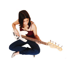 Sitting woman playing guitar. (rockcamp.de) Tags: portrait musician music woman white playing girl beautiful horizontal female hair studio relax person holding pretty artist sitting floor adult legs guitar background young lifestyle jeans musical instrument attractive casual leisure inside recreation practice brunette lovely relaxation youngadult guitarist pleasure isolated instrumental talented caucasian twenties