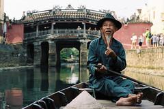 Boatman of Hoi An (peter stewart photography) Tags: bridge man film 35mm japanese boat kodak an vietnam portra hoi