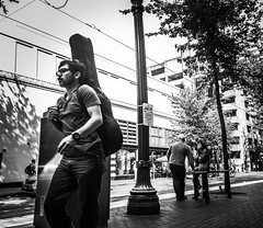 Music To Go (TMimages PDX) Tags: road street city people urban blackandwhite monochrome buildings portland geotagged photography photo image streetphotography streetscene sidewalk photograph pedestrians pacificnorthwest avenue vignette fineartphotography iphoneography