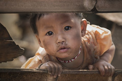 (silvia pasqual) Tags: world poverty travel portrait people baby sun color colors beautiful beauty childhood canon children asian person eyes colorful asia village child looking state little burma culture portraiture soul documentaries myanmar traveling travelers reportage 6d curiously birmania