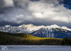 Light on the Lake (Thousands of Jackdaws) Tags: canada alberta jasper pyramidlake light mountains snow lake frozen