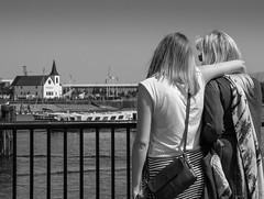 Friends forever looking over Cardiff Bay (All I want for Christmas is a Leica) Tags: girls friends church monochrome lumix blackwhite outdoor cardiff panasonic norwegian hd cardiffbay friendsforever 1442mm panasoniclumixgf6