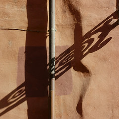 Danza d'Ombre.  A Dance of Shadows. (sandroraffini) Tags: shadows abstract reality light surfaces surreal arabesques ballet urban details exploration warm colors bologna old town lines curves ancient walls minimal square format