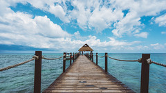 Paradise Beach (KD Robinson) Tags: ocean travel seascape color detail beach water beautiful mexico boats pier dock view cloudy perspective hut oceanview mx impressive quintanaroo travelphotography