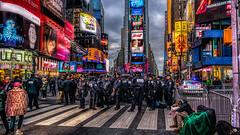 The Gathering (Gordon McCallum) Tags: nyc newyork neon crossing sony nypd mcdonalds timessquare sigmaartlens sonya6000 newyearpreparations