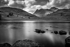 Blea Tarn (Ian Emerson (Looking forward to a Scotland trip)) Tags: mountains water canon landscape rocks lakedistrict cumbria 1855mm tarn silky glassy langdale hoya blea ndx400