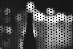 Bottle on the Balcony (jamie.jones113) Tags: blackandwhite bw film monochrome analog zeiss 35mm canon 50mm bottle cosmopolitan wine lasvegas bokeh balcony alcohol 35mmfilm delta3200 ilford ze filmgrain planar lasvegasboulevard elan7 ilforddelta3200 lasvegasstrip carlzeiss canonelan7 ilfordfilm planart1450 planar5014ze