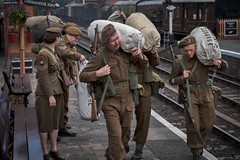 Home on leave. (f22photographie) Tags: reenactors severnvalleyrailway periodcostume candidphotography kitbag heritagerailways 1940sweekend armypersonnel bewdleyrailwaystation ww2soldiers railwayscene severnvalleyrailway1940sweekend