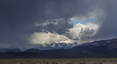 A peek thru the storm clouds (Fred Moore 1947) Tags: sky snow storm mountains clouds landscape us unitedstates desert nevada explore